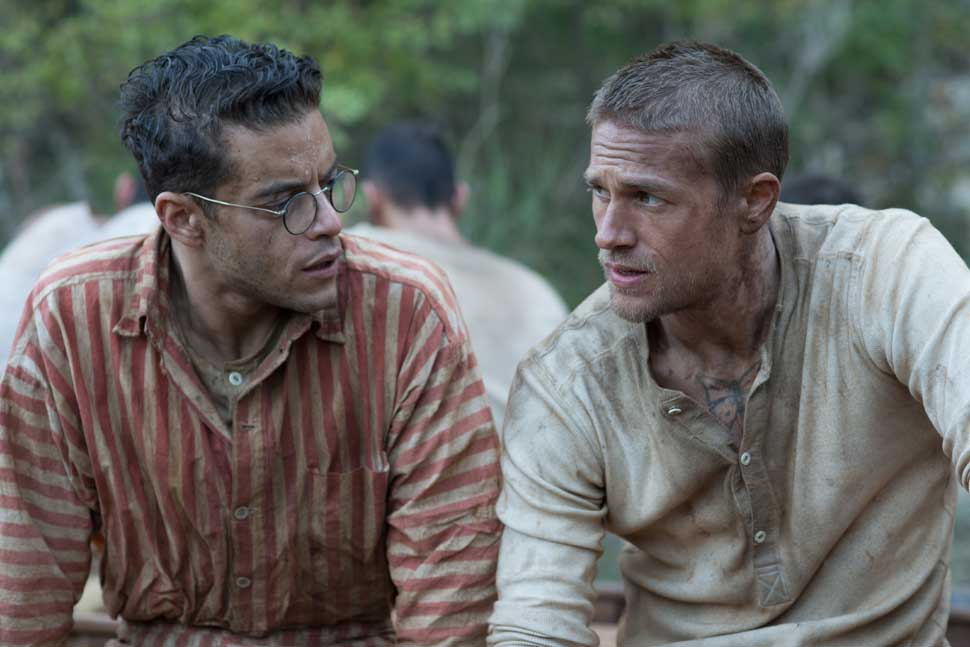 "Rami Malek (left) stars as ""Louis Dega"" and Charlie Hunnam (right) stars as ""Henri 'Papillon' Charriére"" in director Michael Noer's PAPILLON, a Bleecker Street release. Credit: Jose Haro / Bleecker Street"